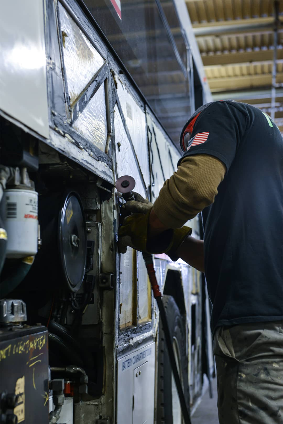 Worker prepping bus